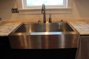 Kohler Vault Apron Front Sink with a Delta Pilar Faucet with Touch Technology